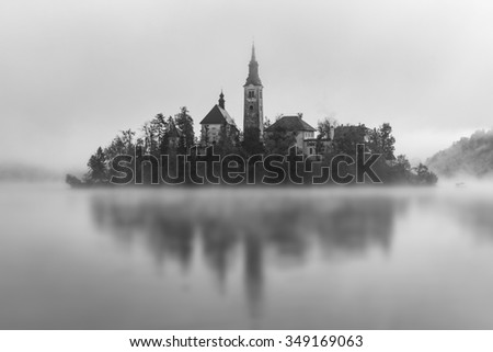 Black and White version of this iconic view on Lake Bled, Slovenia. Amazing still morning with plenty of fog. Breathtaking! - stock photo