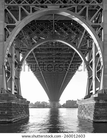 Black and White View from below the Williamsburg Bridge in New York City on a hazy day - stock photo