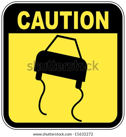 black and  yellow caution sign - road slippery - stock photo