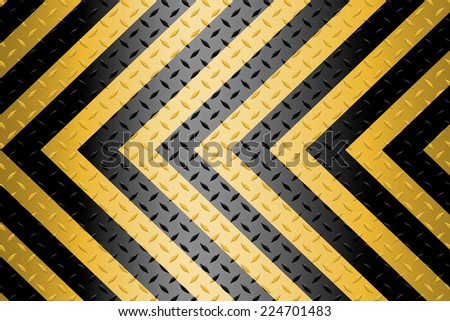 Black and yellow lines on a metal diamond plate  background  - stock photo