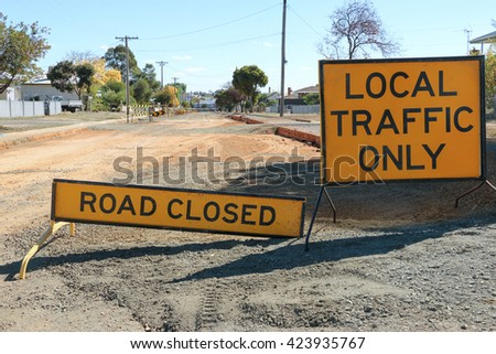 black and yellow Road Closed - Local Traffic Only signs and road - stock photo