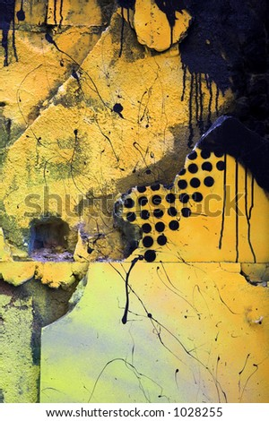 Black and yellow wall. Interesting texture. - stock photo
