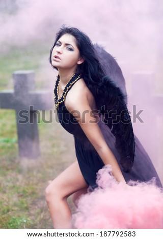 Black angel of war in the mist - stock photo
