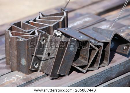 Black angle steel bundle in industrial stockyard.  - stock photo