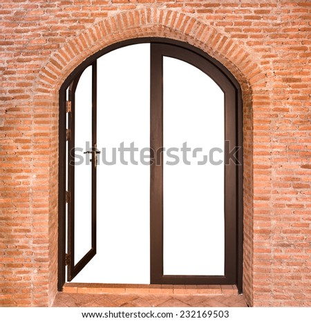Black arch door on red brick wall background - stock photo
