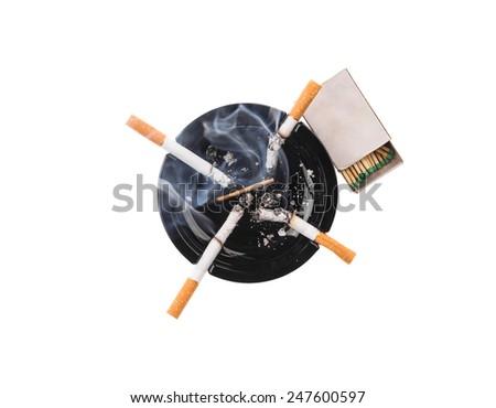 Black ashtray and smoking cigarettes. Isolated on a white background. - stock photo