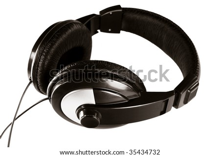 Black audio headphones isolated on white - stock photo