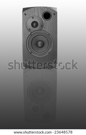 black audio speaker isolated on gradient with reflection - stock photo