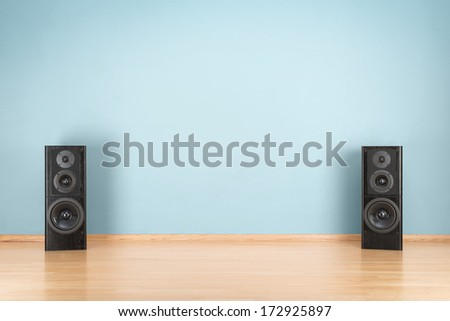 Black audio speakers on the floor - stock photo