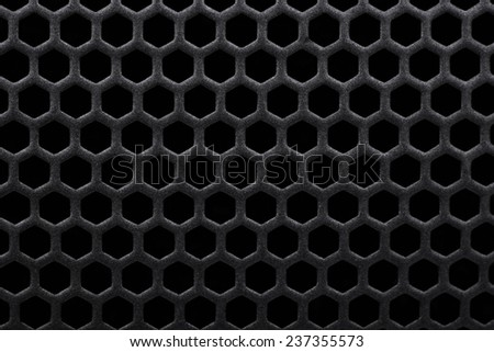 Black background metal grate with holes - stock photo
