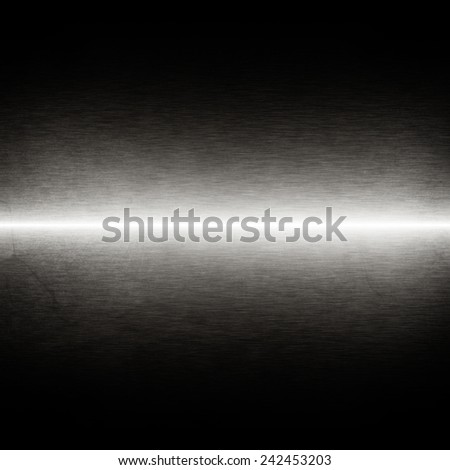 black background shiny metal texture white beam of light - stock photo