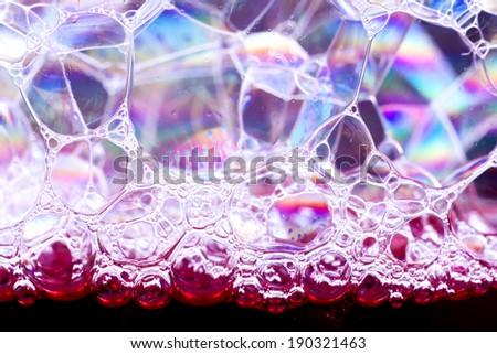 Black background texture of soap bubbles closeup. - stock photo