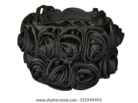 Black bag with roses on white background - stock photo