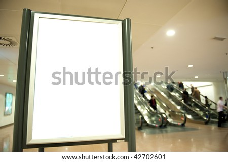 Black banner at airport with blurred people - stock photo