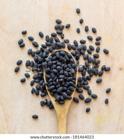 Black beans or Black turtle bean, shallow DOF - stock photo