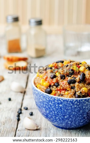 black beans, quinoa and corn chili on a white wood background. the toning. selective focus - stock photo
