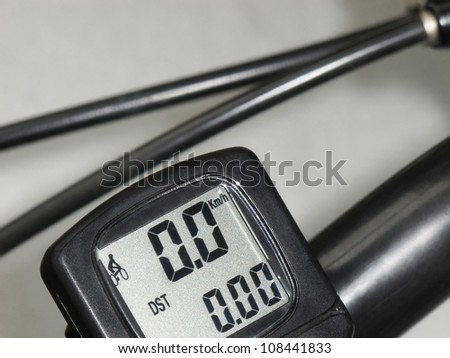Black bicycle  electronic speedometer odometer on gray background - stock photo