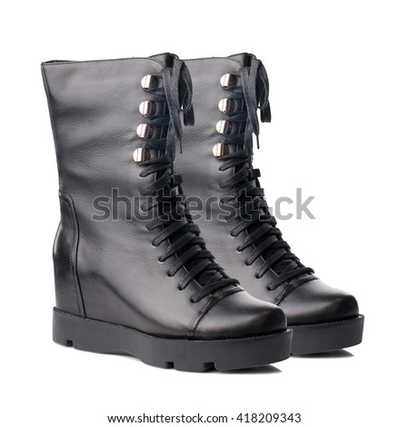 Black biker high boots isolated on white background. - stock photo