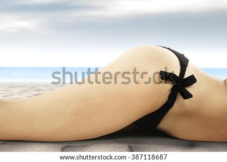 black bikini and sand  - stock photo