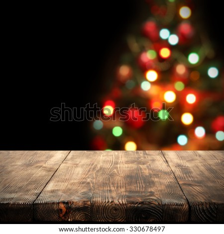 black blurred background of christmas tree desk space and space for you  - stock photo