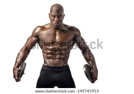 Black bodybuilder posing with round discs. Strong man with perfect abs, shoulders,biceps, triceps and chest. Isolated on white background - stock photo