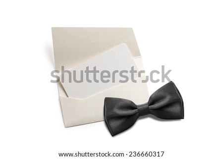Black bow tie with blank invitation - stock photo