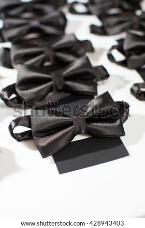 Black bowtie. Black bowtie on a white background.  Dress code parties. - stock photo