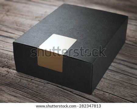 Black box with golden sticker - stock photo