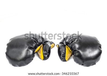 Black boxing gloves on a white background. - stock photo