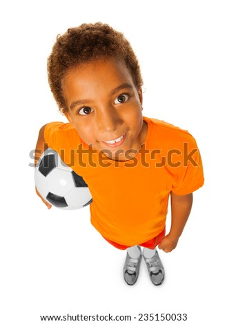Black boy with soccer ball view from above - stock photo