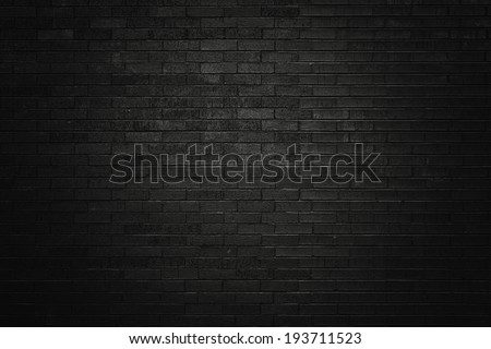 Black brick wall for background  - stock photo