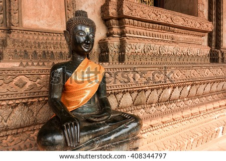 Black Buddha at Hor Phra Kaew in Vientiane.  Laos - stock photo