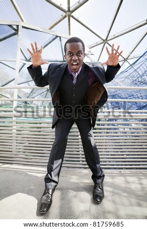 Black business man in grey suit with violet chemise getting crazy. Modern spider architecture as symbol for business network or social network. - stock photo