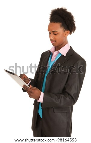 Black business man with tablet PC isolated over white background - stock photo