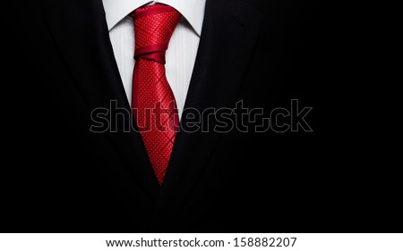 Black business suit with a tie - stock photo