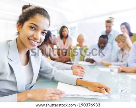Black Business woman in conference with associates - stock photo