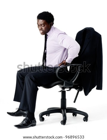 Black businessman in pain from sitting on his office chair with bad posture, long working hours concept. isolated on white - stock photo