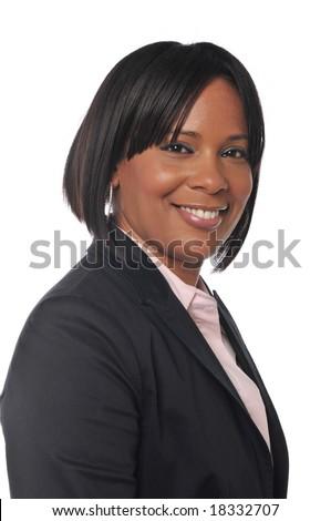 Black businesswoman portrait smiling against a white background - stock photo