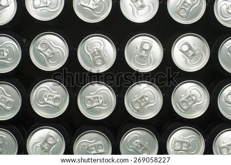 black canned drinks in dark - stock photo