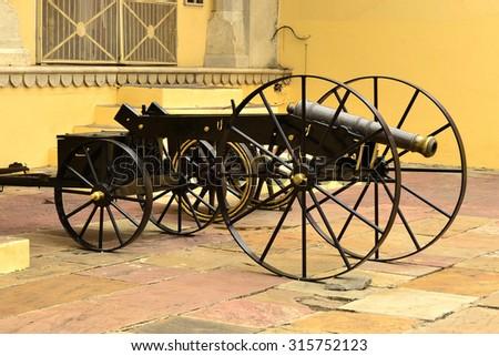 Black cannon in Chandra Mahal, City Palace at Pink City, Jaipur, Rajasthan, India. - stock photo