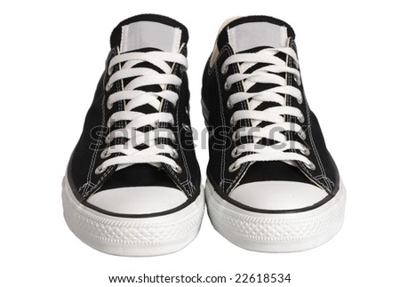 Black canvas sneakers, front view, isolated, clipping path - stock photo