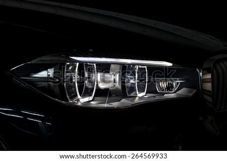 Black car headlight with backlight. Exterior detail. - stock photo