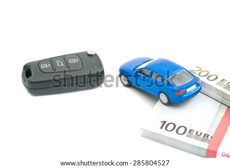 black car keys, blue car and euro banknotes on white - stock photo