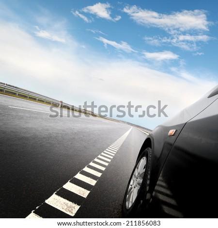 Black car on the european autoban - stock photo