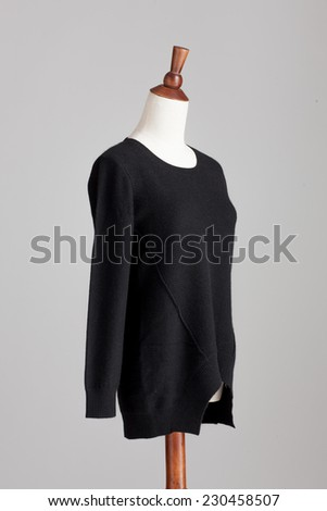 black cashmere sweater with wood model on grey isolated - stock photo