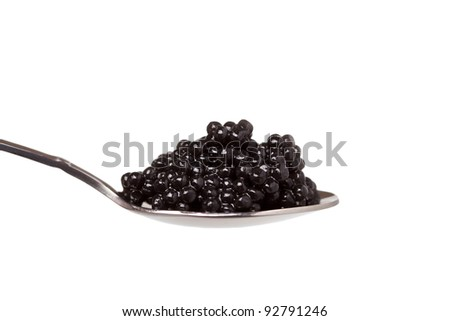 black caviar in spoon on white background - stock photo