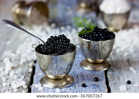 Black caviar, luxurious delicacy appetizer. Selective focus - stock photo