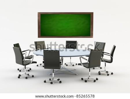 Black chairs around a light office table with a chalkboard - stock photo