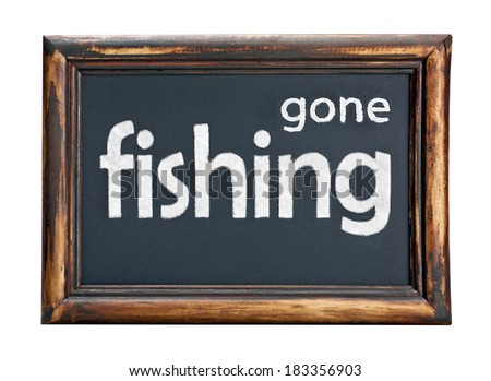 Black chalk board with the inscription gone fishing - stock photo
