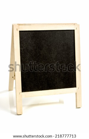 Black chalk drawing board with wooden frame on legs isolated on white background - stock photo